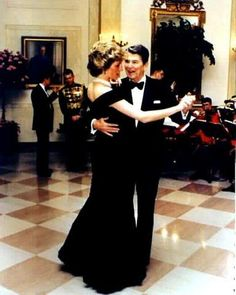 November 9, 1985: Princess Diana at a State dinner given by President and Mrs Reagan at the White House, Washington, D.C. She is pictured dancing with President Reagan.