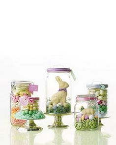 "{Easter decor} Fill glass jars with colorful layers of bulk candy for quick and festive centerpieces. Or, create an Easter basket effect by nestling a white-chocolate bunny or lamb in green paper ""grass."" Finish with ribbon and a tag, or attach a note to the lid using double-sided tape"