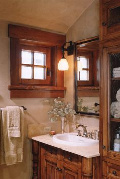 Another one of those lovely windows. A small, warm, cozy, looking bathroom.