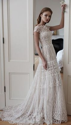 Chic short sleeve uniquely embroidered wedding dress; Featured Dress: Steven Khalil