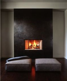 | FIREPLACE | DETAIL -  Simple fireplace surround with casual seating. Image Credit: Plum Pretty Cary Bernstein Architects #fireplace