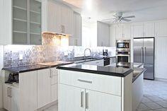 Rénovation de cuisine par Rénom3 Design