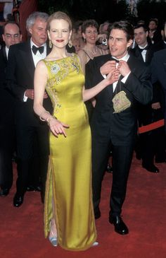 Nicole Kidman, Tom Cruise 1997. Beautiful dress - very unforgiving.