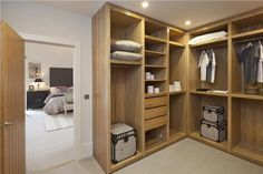 Walk-in dressing room with fitted to ceiling wardrobes off master bedroom