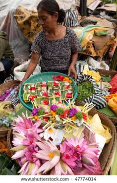 BALI - Commercial activities in the main Ubud market, showing florist selling flower products, in Bali Indonesia.
