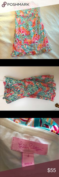 Lilly Pulitzer flamingo strapless dress Beautiful strapless dress with boning on the inside and a tie back. In great condition and has been dry cleaned. It is a size four and hits mid thigh. Super cute dress for spring and summer! The dress is cotton. Lilly Pulitzer Dresses Mini
