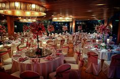 Red themed Chinese wedding ballroom set up with large centerpieces