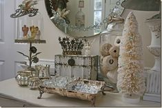 silver and cream..so beautiful Love the rusty box and crown, and jar full of cotton thread!