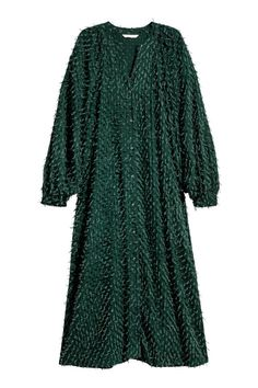 Straight-style, knee-length, V-neck dress in a textured weave with tassels, buttons down the front and wide 3/4-length raglan sleeves with buttoned cuffs. U