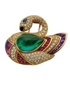 Th THE ART OF BULGARI: DOLCE VITA AND BEYOND Swan brooch, 1990  Gold with emerald, sapphire, onyx, amethysts, rubies, and diamonds