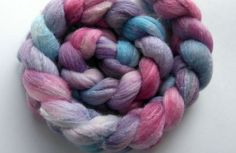 100g (3.5 oz) spinning roving 85% polwarth wool+15% tussah silk - super luxurious, long smooth fibres with the sweet texture of silk. hand-dyed by Oceanwind Knits. handwash recommended, but will not felt.