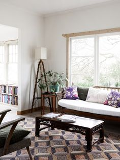 vintage living room with beautiful rug and furniture - Tamsin Carvan and Family — The Design Files