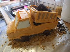 So here is the cake I did for chub-a-bub's first birthday. Not like he cared what it was, but I wanted to see if I could make a dump truck c...