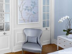 A custom de Gournay wallpaper panel hangs above a vintage chair in Fabricut's Chemical bond faux leather.