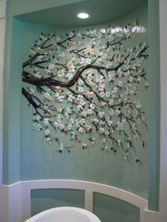 Designer Glass Mosaics - Dogwood Branch - I covet this wall!Bathroom tile installation by Designer Glass Mosaics. You could easily do this in a bedroom by painting a branch and gluing on flowers.Fantastic fused glass elements for the home from Design Stained Glass Art, Mosaic Glass, Mosaic Tiles, Wall Tiles, Fused Glass, Glass Tiles, Mosaic Wall Art, Tiling, Tile Murals