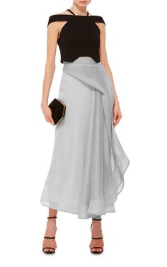 This **Maticevski** skirt features a high rise with a fitted waistband, a tonal wraparound design that falls into cascading ruffles at the side, and an ankle length asymmetric hem.