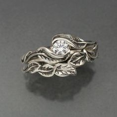 $280 delicate leaf wedding ring set- If I could get the setting with a different stone, it would be amazing.