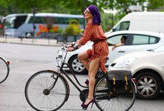 Catherine Baba: Cycling in style. Check out those heels