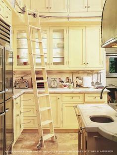 library ladders, in the kitchen.  Great for the vertically challenged.
