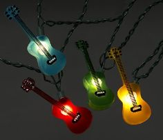 Get ready to rock and roll by lighting up the stage with these multi color guitar party string lights! Great for any music themed party, band room, or studio. Includes 10 multi colored guitars, two of each of the five colors, spread out on an ft wire Guitar Party, Band Rooms, Novelty Lighting, Music Gifts, Party Lights, String Lights, Light Colors, Colours, Christmas Lights