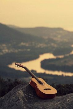 Learn to play guitar, and travel the world and play FOR PEOPLE.