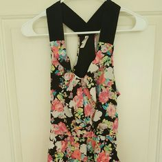 NWOT Floral dress Floral racer back dress with ruffle in front.  By Xhilaration. Size S but runs a bit bigger. New without tags. Xhilaration Dresses Midi
