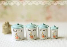 Organization is important, even in miniature. Dollhouse kitchen canisters by miniaturepatisserie