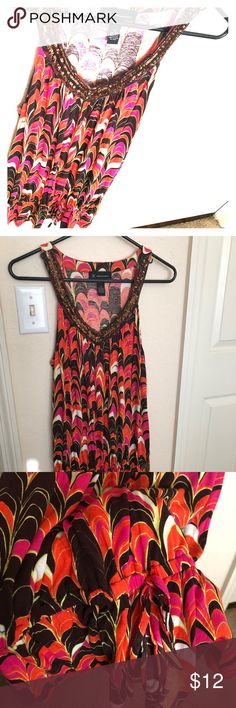 HOT DEAL💥INC💥sleeveless top Standout in style with this sleeveless INC design! The top includes an embellished v cut neckline and draw string bottom. Size medium. Excellent condition. INC International Concepts Tops Tank Tops
