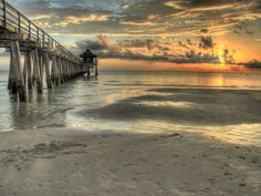 Historic Naples Pier extends out into the Gulf of Mexico and is a popular spot for casting a line (no need for a fishing license) or watchin...