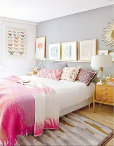 A mix of eclectic textiles, interesting art, and gold accents lend this girly, bright bedroom, a dose of elevated cool.