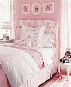 retired Pottery Barn Kids bedding. Headboard is upholstered pink toile, animal silhouettes would be easy to make, the bedding is accented with dots