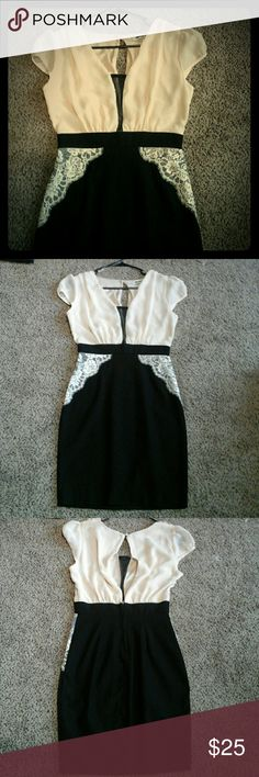 Like new Mystic dress by Modcloth  sz med Black and cream color with black sheer panel in front, split back, pencil skirt and waist band  is stretchy. B 16, W 13, L 34 Hand wash cold or Dry clean . ModCloth Dresses