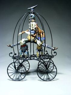Hanging display 4 Faeries... assemble base 2 cage over doll, legs,arms 7 wings protruding... Gumaelius. 2013