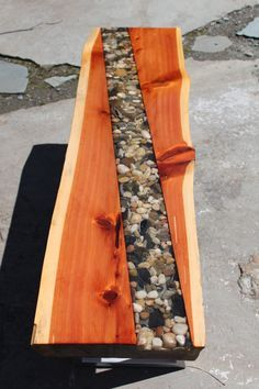 is a lovely eastern red cedar bench with river pebble inlay. Completely sealed in acrylic, these pebbles are beautiful to look at and offer a nice contrast to the rich orange/red colored wood. Resin Furniture, Log Furniture, Custom Wood Furniture, Into The Woods, Resin Table, Wood Table, Wood Benches, Wooden Desk, Diy Table