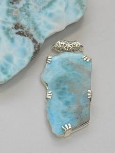 Jewelry OFF! Organic free-form polished Caribbean Larimar pendant suitable for men or women prong-set in sterling silver with scrollwork detailing. Sea Glass Jewelry, Stone Jewelry, Metal Jewelry, Pendant Jewelry, Jewelry Art, Sterling Silver Jewelry, Jewelry Design, Silver Ring, Silver Earrings