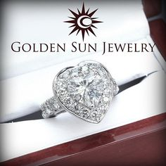 GOLDEN SUN JEWELRY: A beautiful Heart Shaped diamond ring. This beautiful ring features a 3.00ct. Heart shaped center stone that is accented by the pave halo and prong set band. A lavish ring!  #gold #bride #bridal #married #marriage #engaged #engagement #hearts #ring #certified #luxury #lavish #kardashian #stunning #fashion #bridetobride #fashionista #fashion
