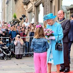 The Queen was presented with two posies and greeted by crowds on her departure from The Royal Society of Edinburgh on the last day of #HolyroodWeek #RoyalWeek.