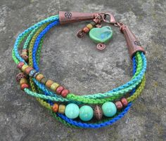 Boho Spring Greens Beadwork Bracelet, Beaded Macrame Bracelet with Heart, Hand-Knotted with Copper Beaded Bracelet. $32.00, via Etsy.