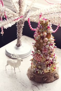 pink beads and bauble Christmas tree with a vintage beaded collar as a tree skirt-sweet!