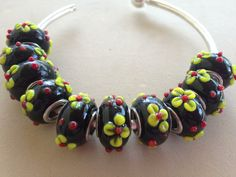 Stunning Black Lampwork Glass Euro Beads with Raised Flowers on Etsy, $4.00