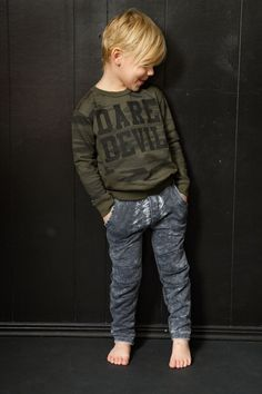 A new twist on Joah Love's signature Dare Devil shirt- with a camo backdrop on a sweatshirt. Available in sizes 2T - 6 years. Toddler boys fashion