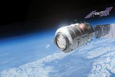 An artist's concept of Orbital Sciences' unmanned Cygnus cargo spacecraft approaching the International Space Station.