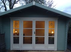 all painted and lit up just waiting to be enjoyed this summer log cabin garden rooms can make such a difference to your lifestyle tiger sheds