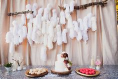 a crazy good cake table Design by http://www.jesihaackdesign.com/  Photography: Mr. Haack, http://www.mrhaack.com/blog/   Read More: http://www.stylemepretty.com/2014/05/19/bohemian-glamour-in-northern-california/