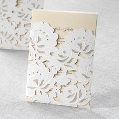 Floral wedding invites in cream and white are so elegant and pretty!