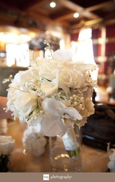 White on White Bouquet...  kinda like the idea of the brides bouquet being white and bridesmaids carrying a purple bouquet