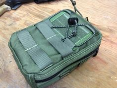 DIY First Aid Pouch I put together.  Uses 1000d cordura and mil spec components. See here for more images:  http://imgur.com/a/g27Qr#13