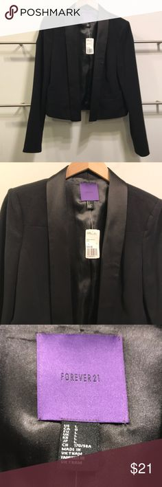 FOREVER 21 CROPPED BLAZER BRAND NEW TAGS LARGE This is a brand new with tags forever 21 cropped blazer. It is black in color and has a satin trim down front. It is really a great one. Size is large Forever 21 Jackets & Coats Blazers