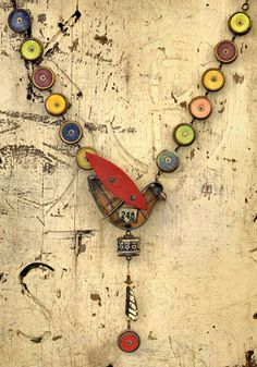 Bird #24 Neckpiece in cardboard game pieces, Chris Giffin : metal cookie cutter, metal tag, fishing spinner, dial, vintage sewing tool, vintage tin, and brass findings