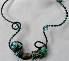 """First of the """"Small Arms"""" jewelry - collar of colorized doll arm with turquoise and aluminum wire.                                           Gilding the Lily by Candace Eck"""